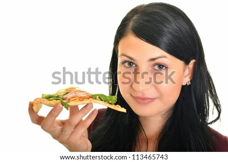 young woman eating a piece of pizza against a white background