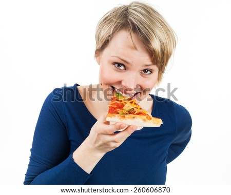 Young woman eating a piece of pizza, isolated on white - stock photo