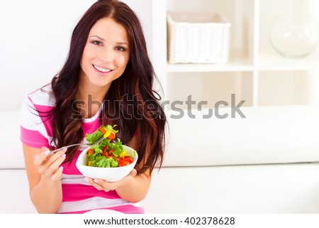 Young woman eating a salad