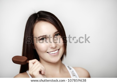 young woman eating a small ice cream - stock photo
