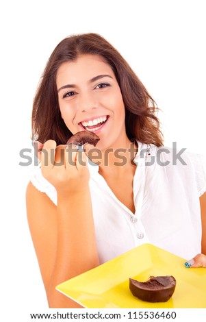 Young woman eating chocolate cake - stock photo