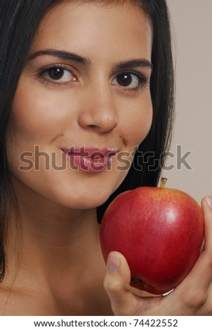 Young woman eating fresh apple.