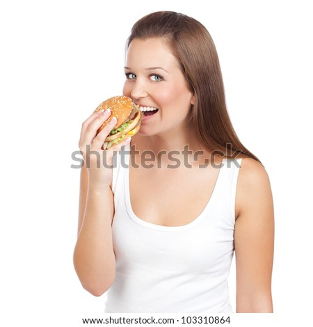 Young woman eating hamburger, isolated on white - stock photo