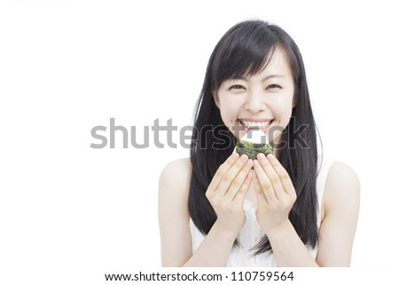 "young woman eating Japanese rice ball ""onigiri"", isolated on white background - stock photo"