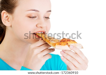 Young woman eating pizza. Isolated on white.