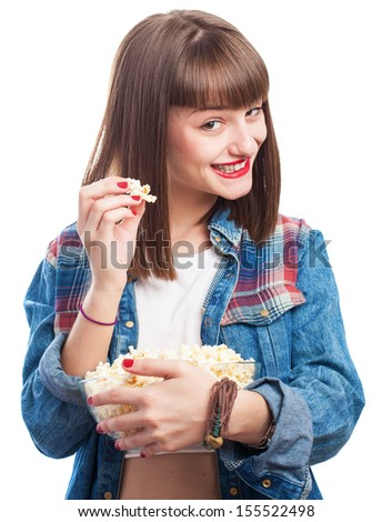 young woman eating popcorn on white background - stock photo