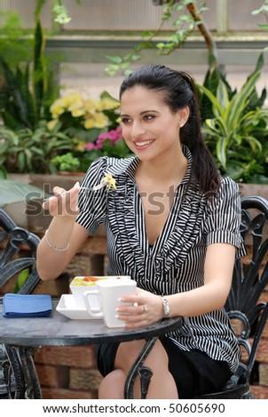 young woman eating salad - stock photo
