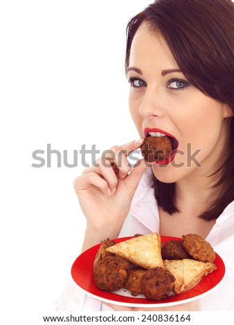 Young Woman Eating Selection of Indian Snack Food