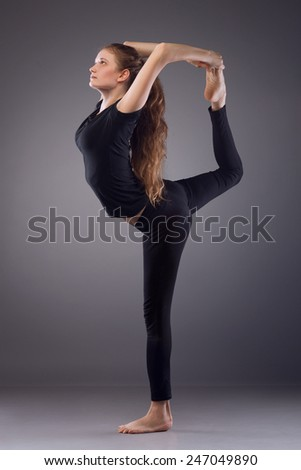 Young woman engaged in yoga on the floor - stock photo