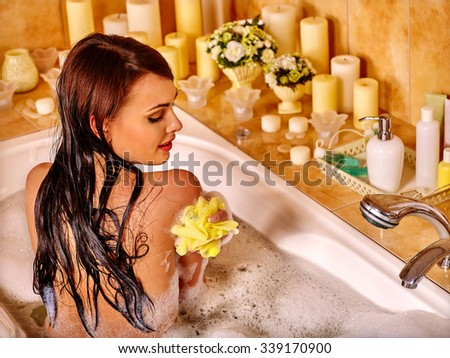 Young woman enjoing in hot bath. - stock photo