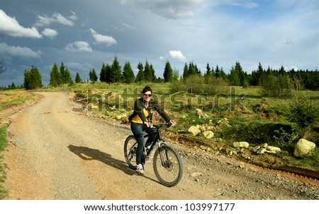 Young woman enjoy a mountain bike trip. Outdoor activity