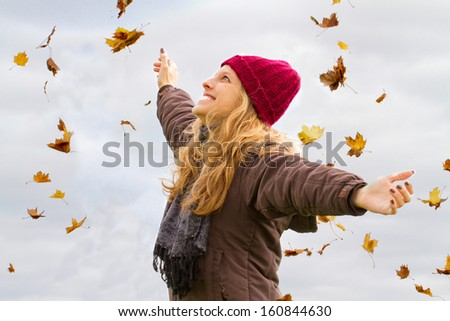 Young woman enjoy autumn - stock photo