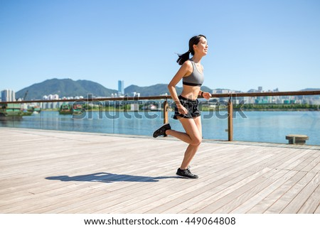 Young Woman enjoy running at outdoor
