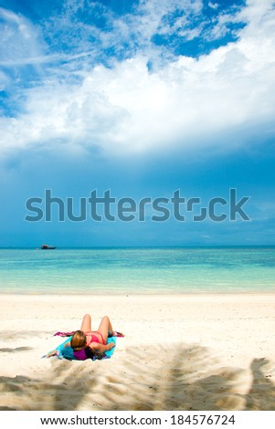 Young woman enjoying a day at the beach - stock photo