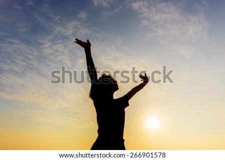 Young woman enjoying beautiful - stock photo