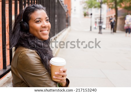 young woman enjoying coffee and music. - stock photo