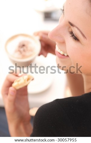 Young woman enjoying coffee time - stock photo