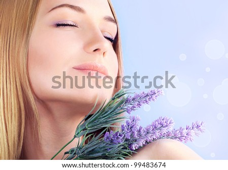 Young woman enjoying lavender flower scent, close up on clean skin female face, sensual girl at spa aromatherapy, health and beauty treatment, wellness concept - stock photo