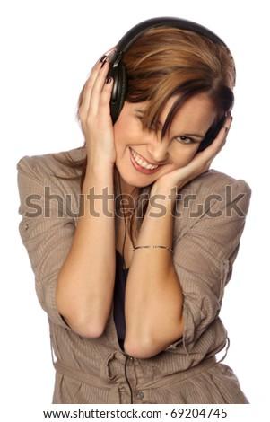 young woman enjoying listening to music - stock photo