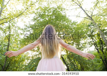 Young woman enjoying nature in green forest-woman enjoying nature - stock photo