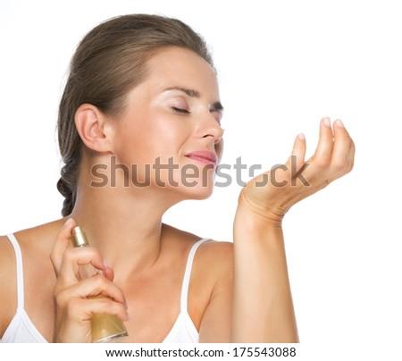 Young woman enjoying perfume - stock photo