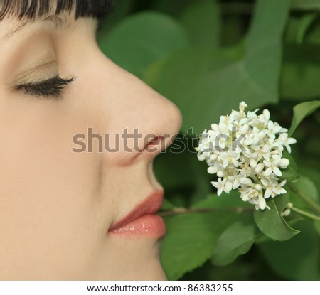 Young Woman Enjoying Smelling aroma Flowers - stock photo