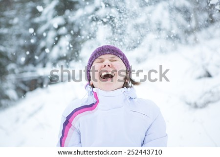 young woman enjoying snowy winter