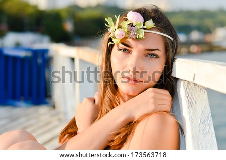 Young woman enjoying sunny day on the beach - stock photo