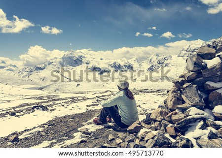Young woman enjoying the mountain view.