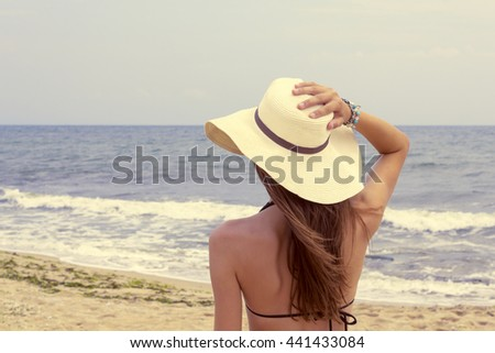 Young woman enjoying the oceanâ??s view in a summer vacation. - stock photo