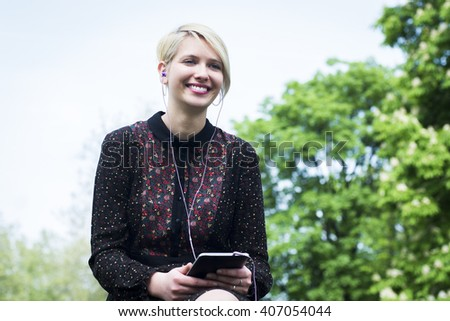 Young woman enjoying the park  - stock photo