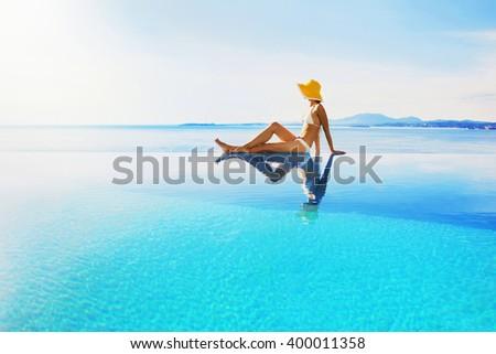 Young woman enjoying the sun - stock photo