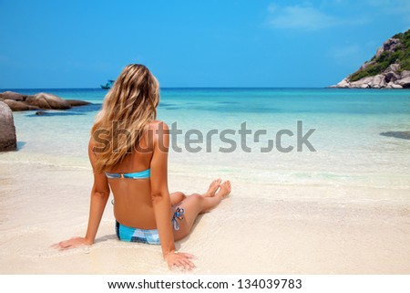 Young woman enjoying the sunshine on a tropical beach