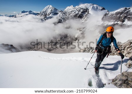 Young woman enjoying the view during mountain ascent - stock photo