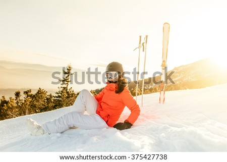 young woman enjoying the view from mountain slopes, relaxing - stock photo