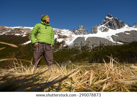 Young woman enjoys beautiful view into high mountains, Patagonia, South America