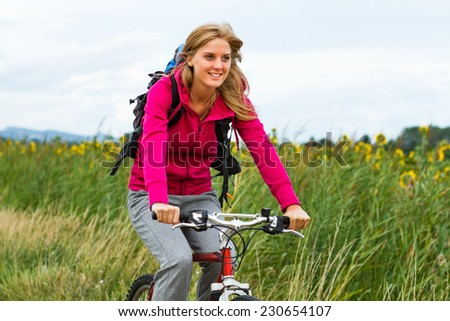 Young  woman enjoys riding a bicycle,Cycling