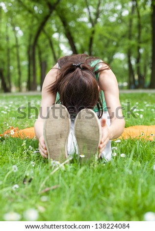 Young Woman Excercising in Park
