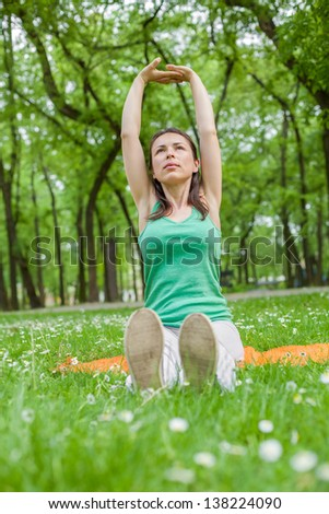 Young Woman Excercising in Park - stock photo