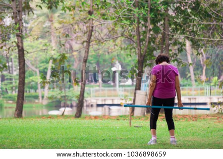 Young Woman, Exercise In Gardent Background,copy Space.