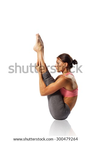 Young woman exercise yoga pose - isolated at white background  - stock photo