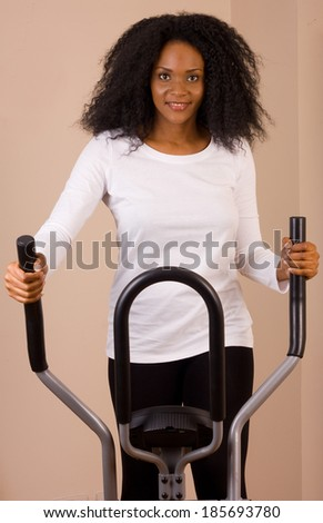 young woman exercising at home.