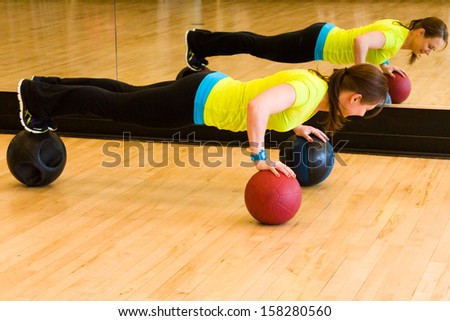Young woman exercising at the gum.