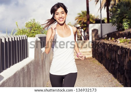 Young woman  exercising in an urban park
