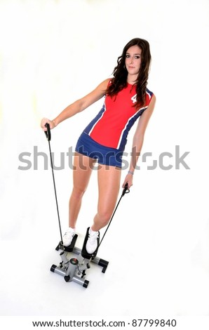 young woman exercising on stepper trainer, vertical