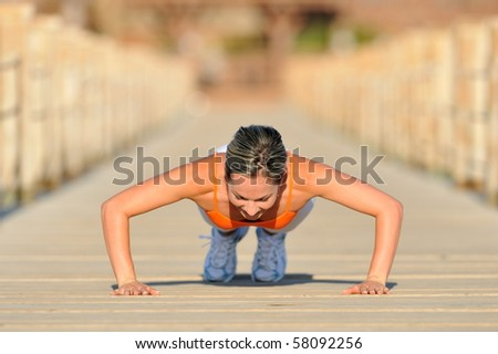 young woman exercising outdoor in summer - stock photo