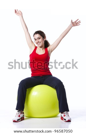 young woman exercising with a yellow pilate ball - stock photo