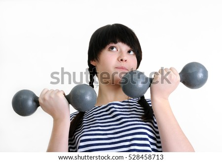 young  woman exercising with two old dumbbells on white background