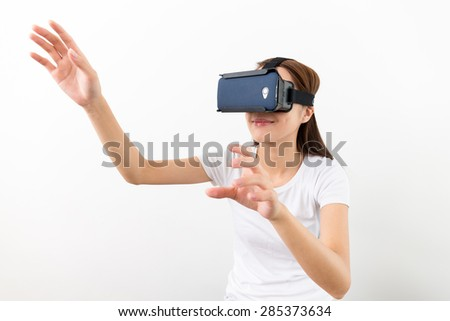 Young Woman experience virtual reality on cellphone - stock photo