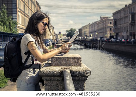 Young woman exploring the city map